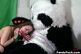Titted brunette to have sex with huge toy panda