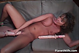 Brunette MILF grabs red dildo and slides it in