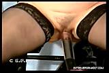 Handcuffed brunette gets her tits vacuum pumped
