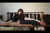 Domineering mistress jerks off a man in an unusual way