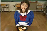 Japanese girl eats and drinks cummy food