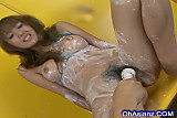 Sexy asian babe rubbing cream all over her perky body