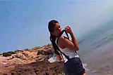 Suzana strips on the sand  FM14