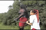 mistress spanks slave girl outdoor