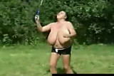 Busty grannie playing badminton