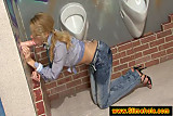 Skinny blonde visiting the glory hole