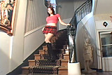 Big boobed babe masturbates on a stairway.