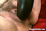 Horny woman riding a black dildo