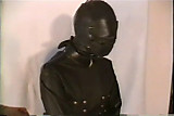 Woman in Leather Hood and Straightjacket