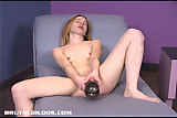 Teen riding a brown brutal dildo